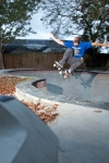 Sean Davis, Frontside Ollie over the hip in a Florida backyard pool. Photo_Nick Perry